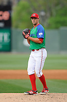 Relief pitcher Reed Reilly (33) of the Greenville Drive delivers a pitch in a game against the Augusta GreenJackets on Sunday, April 12, 2015, at Fluor Field at the West End in Greenville, South Carolina. Augusta won, 2-1. (Tom Priddy/Four Seam Images)