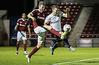 Matthew Bloomfield of Wycombe Wanderers (right) battles for the ball during The Checkatrade Trophy match between Northampton Town and Wycombe Wanderers at Sixfields Stadium, Northampton, England on 30 August 2016. Photo by David Horn / PRiME Media Images.
