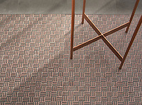 Cabin Weave, a hand-cut tumbled mosiac, shown in Nero Marquina and Red Lake, is part of the Tissé™ collection for New Ravenna.
