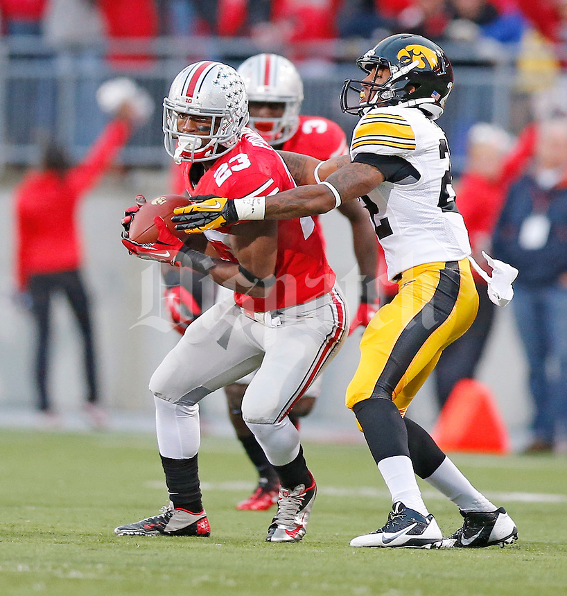 Ohio State Buckeyes defensive back Tyvis Powell (23) intercepts a fourth quarter pass meant for Iowa Hawkeyes wide receiver Damond Powell (22) at Ohio Stadium on October 19, 2013.  (Chris Russell/Dispatch Photo)