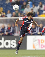 New England Revolution defender Kevin Alston (30) volleys the ball. In a Major League Soccer (MLS) match, the New England Revolution defeated Chicago Fire, 2-0, at Gillette Stadium on June 2, 2012.