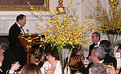 Governor Michael D. Huckabee (Republican of Arkansas) Chairman of the National Governor's Association offers a toast to United States President George W. Bush at a State Dinner in the State Dining Room of the White House in Washington, D.C. on February 26, 2006.<br /> Credit: Dennis Brack - Pool via CNP