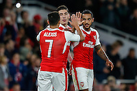 Theo Walcott of Arsenal (right) celebrates scoring his team's 2nd goal of the game to make it 2-0 with Alexis Sanchez of Arsenal (left) during the UEFA Champions League match between Arsenal and PFC Ludogorets Razgrad at the Emirates Stadium, London, England on 19 October 2016. Photo by David Horn / PRiME Media Images.