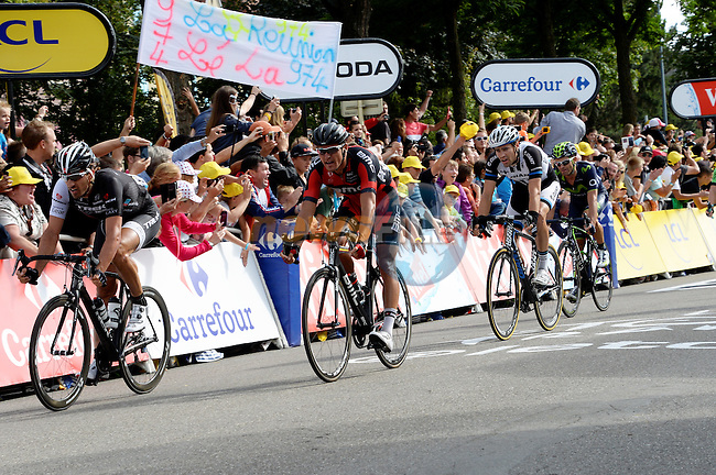 The chasing group Fabian Cancellara (SUI) Trek Factory, Greg Van Avermaet (BEL) BMC Racing, Tom Dumoulin (NED) Giant-Shimano and Jose Joaquin Rojas Gil (ESP) Movistar cross the line 2'45'' down on winner Tony Martin (GER) Omega Pharma-Quick Step at the end of Stage 9 of the 2014 Tour de France running 170km from Gerardmer to Mulhouse. 13th July 2014.<br />