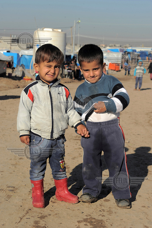 Two young boys, hand-in-hand at the Kawergosk Syrian Refugee Camp.