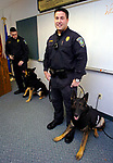 FILE....Manchester Police Officer Michael Ilewicz (ILEWICZ) and Officer Richard Boyle and  his dog Marko, after a K9 vest presentation Friday at Manchester Police Headquarters, the 2 K9 teams received the vests by the Christina Poryanda, Executive Director of Connecticut Vest-A-Dog. A Jim Michaud pic 2/23/06