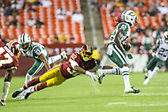 Landover, MD - August 16, 2018: Washington Redskins defensive back Ranthony Texada (32) tries to tackle New York Jets wide receiver Lucky Whitehead (82) during the preseason game between New York Jets and Washington Redskins at FedEx Field in Landover, MD.   (Photo by Elliott Brown/Media Images International)