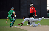 Ireland V UAE - World T20 Super Four stage qualifying cricket match in Dubai Sports City Cricket Stadium - Ireland top scorer Niall O'Brien just evades UAE bowler Arfan Haider's attempt to stop the ball, in front of Umpire Jeff Luck - Picture by Donald MacLeod 12.02.10