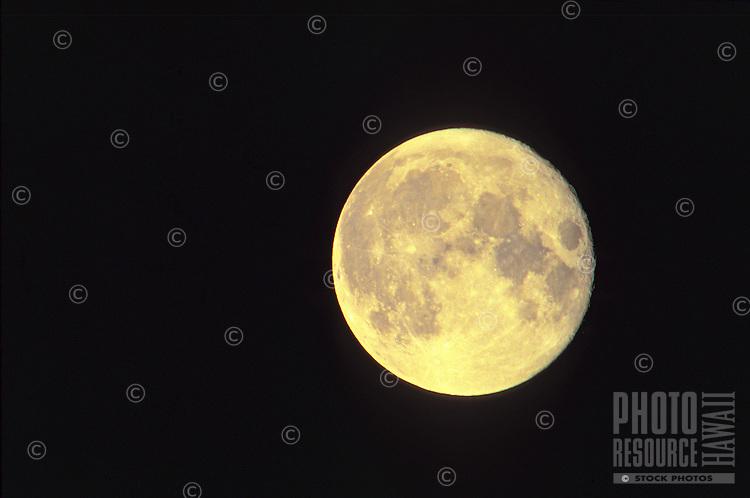 Luminous full moon against a black sky.