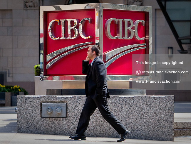 A man talking on his cell phone walks by a CIBC logo in Toronto financial district April 19, 2010. The Canadian Imperial Bank of Commerce (in French, Banque Canadienne Imperiale de Commerce, and commonly CIBC in either language) is one of Canada's chartered banks, fifth largest by deposits.