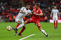 Alex Muscat of Malta (right) challenges Marcus Rashford (Manchester United) of England during the FIFA World Cup qualifying match between England and Malta at Wembley Stadium, London, England on 8 October 2016. Photo by David Horn / PRiME Media Images.