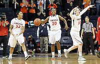 Virginia guard Lexie Gerson (14), Virginia guard Faith Randolph (20) and Virginia guard Ataira Franklin (23) celebrate after the 86-72 win over #6 ranked Maryland Thursday in Charlottesville, VA. Photo/The Daily Progress/Andrew Shurtleff
