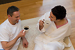 Mature couple holding coffee cups, conversing