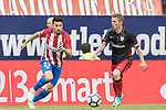 Nicolas Gaitan (L) of Atletico de Madrid fights for the ball with Iker Muniain Goni (R) of Athletic Club during their La Liga match between Atletico de Madrid vs Athletic de Bilbao at the Estadio Vicente Calderon on 21 May 2017 in Madrid, Spain. Photo by Diego Gonzalez Souto / Power Sport Images