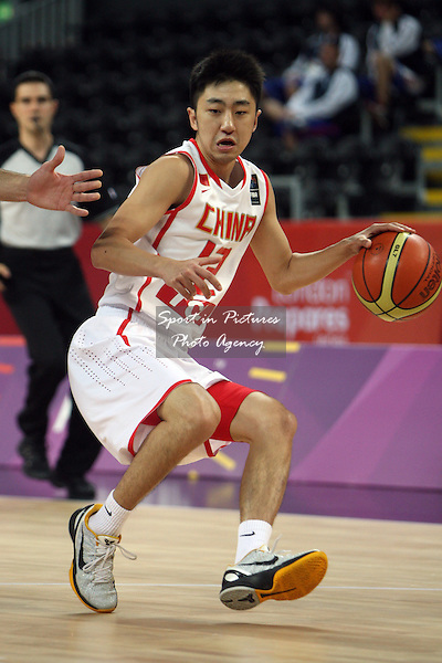Shulong Yu (China) in action. Serbia v China. The London International Basketball Invitational. London Prepares for Olympics 2012. Basketball Arena, Olympic Park. London. 17/08/2011. MANDATORY Credit Sportinpictures/Paul Chesterton - NO UNAUTHORISED USE - 07837 394578.
