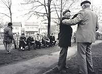 Bosnjak men greet each other on a Friday afternoon outside a mosque in Tuzla, Bosnia.