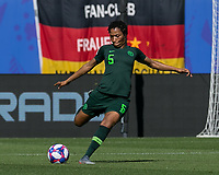 GRENOBLE, FRANCE - JUNE 22: Onome Ebi #5 of the Nigerian National Team clears the ball during a game between Nigeria and Germany at Stade des Alpes on June 22, 2019 in Grenoble, France.