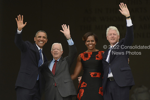 US President Barack Obama (L), former US President Jimmy Carter (2-L), First Lady Michelle Obama (2-R) and former US President Bill Clinton wave from the top of the steps of the Lincoln Memorial at the conclusion of the 'Let Freedom Ring' commemoration event, in Washington DC, USA, 28 August 2013. The event was held to commemorate the 50th anniversary of the 28 August 1963 March on Washington led by the late Dr. Martin Luther King Jr., where he famously gave his 'I Have a Dream' speech.<br /> Credit: Michael Reynolds / Pool via CNP