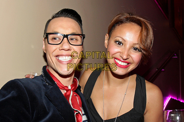 GOK WAN & AMELLE BERRABAH.Attitude's Sweet 16 Birthday Party held at the Mayfair Hotel, London, England, UK. .May 5th 2010.headshot portrait black red neckerchief scarf glasses red lipstick sugababes.CAP/MAR.© Martin Harris/Capital Pictures.