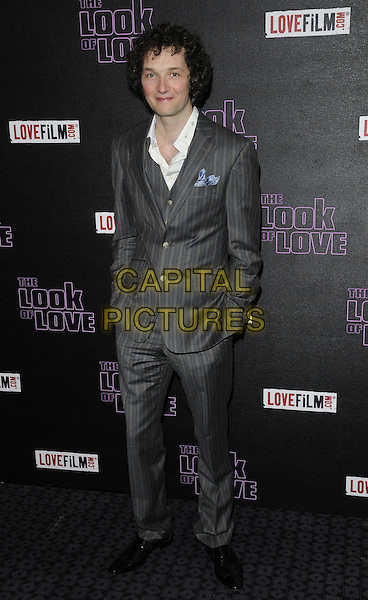 "Chris Addison.attended ""The Look Of Love"" UK film premiere,Curzon Soho cinema, London, England..April 15th, 2013.full length suit jacket stripe beige hands in pockets shirt white  grey gray suit.CAP/CAN.©Can Nguyen/Capital Pictures."