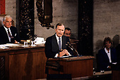 United States President George H.W. Bush speaks to a Joint Session of the U.S. Congress on the situation with Iraq and the Persian Gulf and on the federal deficit in the U.S. Capitol in Washington, D.C. on September 11, 1990. Looking on from left is the Speaker of the US House of Representatives Tom Foley (Democrat of Washington).<br /> Credit: Ron Sachs / CNP
