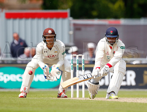 23.05.2016. Old Trafford, Manchester, England. Supersavers County Championship. Lancashire versus Surrey. Lancashire batsman Alviro Petersen plays a reverse sweep on the way to an unbeaten 71 at tea.