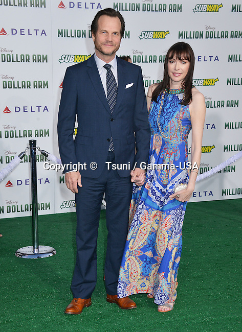 Bill Paxton and daughter  at the Million Dollar Arm Premiere at the El Capitan Theatre in Los Angeles.