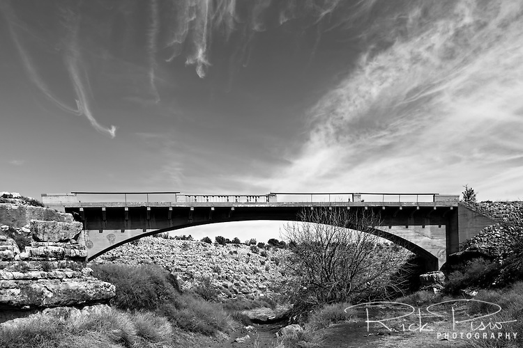 Padre Canyon Bridge spanning the Padre Canyon in Arizona, east of Flagstaff. Once part of the National Old Trails Highway, and later Route 66, it's construction allowed vehicles to pass over Padre Canyon whose steep canyon walls were a major transportation obstacle on the relatively flat Arizona high desert since the days of the Winona-Flagstaff Road. The bridge, classified as a Luten Bridge, was enginereed by Daniel B. Luten and built by the Topeka Bridge and Iron Co. in 1914 for a total cost of $7,900. On September 30, 1988 it was added to the National Register of Historic Places.