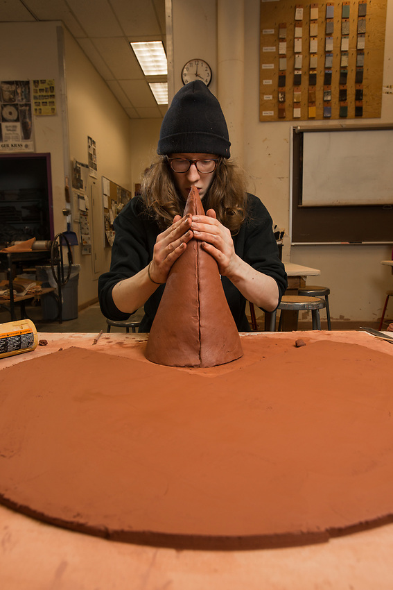 Brian Adams works on a clay sculpture during  Intermediate Handbuilt Ceramics (ART A301) in UAA's fine arts building.