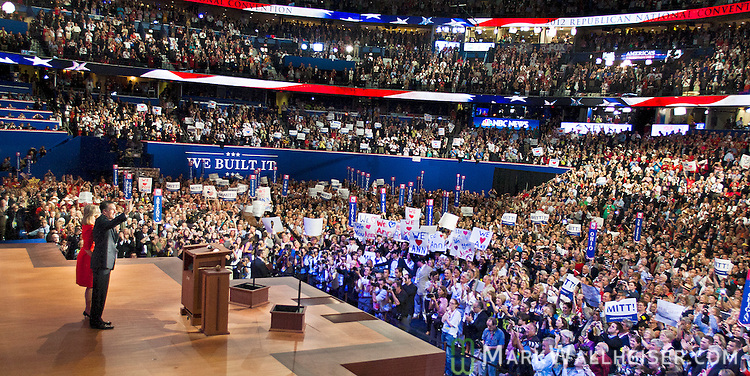 Mitt and Ann Romney wave to supporters at the 2012 Republican National Convention at the Tampa Bay Times Forum in Tampa on August 29, 2012.