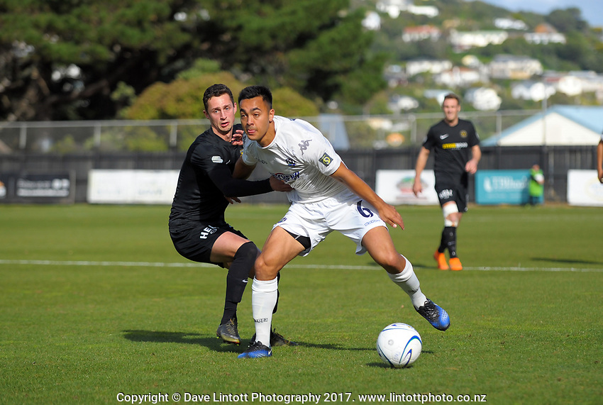 Cam Howieson (Auckland) holds off Cole Peverley during the Oceania Football Championship final (second leg) football match between Team Wellington and Auckland City FC at David Farrington Park in Wellington, New Zealand on Sunday, 7 May 2017. Photo: Dave Lintott / lintottphoto.co.nz