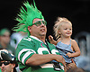 New York Jets fan Dan Cykewick and two-year-old daughter Kate watch the team's annual Green & White practice and scrimmage at MetLife Stadium in East Rutherford, NJ on Saturday, Aug. 5, 2017.