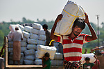 Refugees unload a truck carrying tarps, blankets and other items in the Jamtoli Refugee Camp near Cox's Bazar, Bangladesh. The relief items were provided by Christian Aid, a member of the ACT Alliance.<br /> <br /> More than 600,000 Rohingya have fled government-sanctioned violence in Myanmar for safety in Bangladesh.