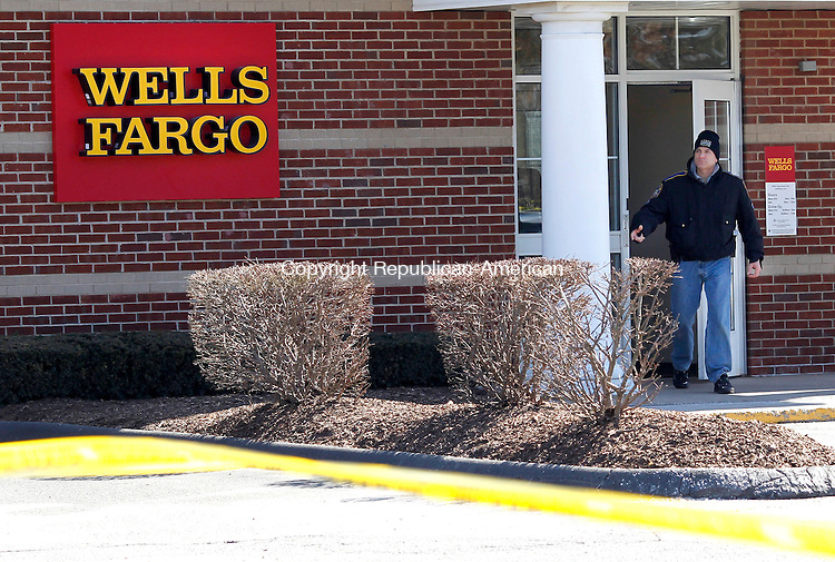 Prospect, CT- 26, March 2011-030261CM02  A State Trooper leaves Wells Fargo Bank following a bank robbery in Prospect Saturday morning.  Two suspects were apprehended following a pursuit by law enforcement officials.  Prospect, Waterbury, Wolcott and Cheshire Police also responded to the incident.  Christopher Massa Republican-American
