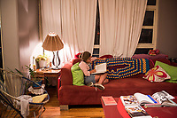 Mila Ortega Smith reading on the sofa. Family at the progreso apartment, Escandon, Mexico City, Mexico