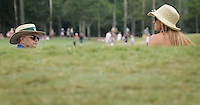 Kelly.Jordan@jacksonville.com--051312--Golf fans wearing a variety of hats are seen peeking above a hill as they walk on the walkway along the 18th fairway during the final round at The Players Championship at TPC Sawgrass Sunday May 13, 2012 in Ponte Vedra Beach, Florida.(The Florida Times-Union, Kelly Jordan)