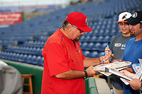 Palm Beach Cardinals pitching coach Randy Niemann (40) signs autographs for fans before a game against the Clearwater Threshers on April 15, 2017 at Spectrum Field in Clearwater, Florida.  Clearwater defeated Palm Beach 2-1.  (Mike Janes/Four Seam Images)