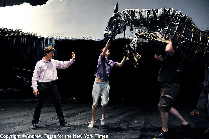 UK. London. 8th July 2009.War Horse Director Tom Morris (left) rehearses with puppeteers Toby Olie, Finn Caldwell and Laura Cubitt at the New London Theatre..©Andrew Testa for the New York Times