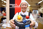 """An employee of Tokyo's Nihonbashi Takashimaya shows a box of chocolates. The department store currently holds a chocolate fair """"Amour du Chocolat!"""" for Valentine's Day."""