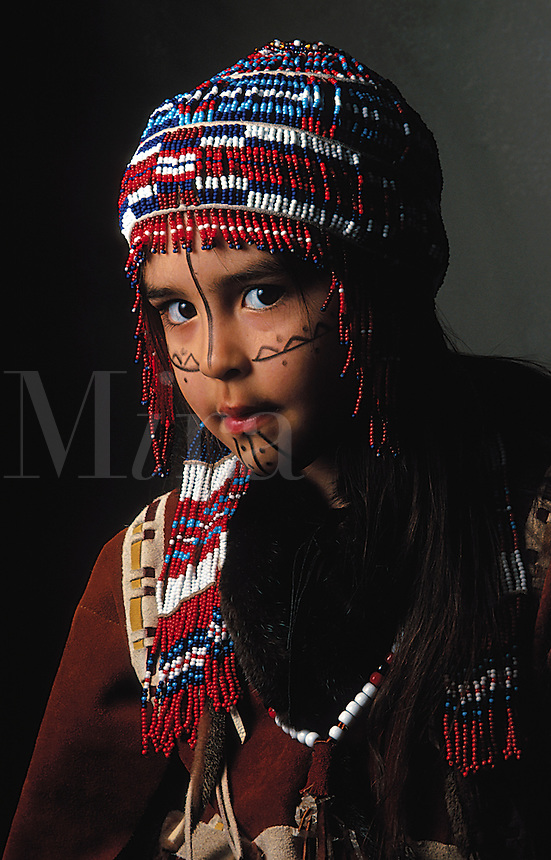 Portrait of a Native Alaskan Alutiq child in a traditional beaded headdress. Alaska.