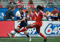 23 May 09: New England Revolution midfielder Steve Ralston #14 and Toronto FC defender Adrian Serioux #15 in action during a game between the New England Revolution and Toronto FC.Toronto FC won 3-1.