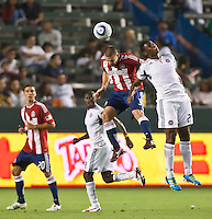 CARSON, CA – July 2, 2011: Chivas USA midfielder Paolo Nagamura (5) and Chicago Fire forward Cristian Nazarit (29) during the match between Chivas USA and Chicago Fire at the Home Depot Center in Carson, California. Final score Chivas USA 1, Chicago Fire 1.