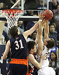 Nevada's Olek Czyz gets fouled as he tries to shoot over Bucknell defenders Mike Muscala and Brian Fitzpatrick during a second round NIT college basketball game in Reno, Nev., on Sunday, March 18, 2012. Nevada won 75-67..Photo by Cathleen Allison