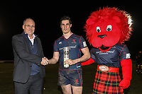 Ross Neal of London Scottish (centre) receives the man of the match award after the Greene King IPA Championship match between London Scottish Football Club and Jersey Reds at Richmond Athletic Ground, Richmond, United Kingdom on 16 March 2018. Photo by David Horn.