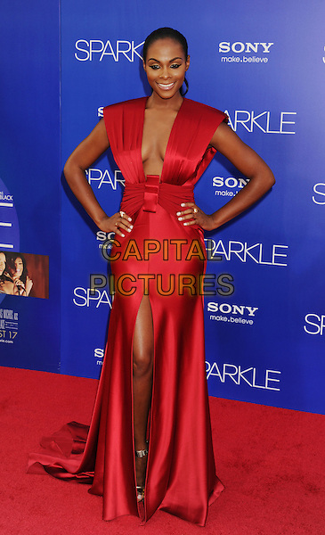 "Tika Sumpter.arriving at the Los Angeles premiere of ""Sparkle"" at Grauman's Chinese Theatre in Hollywood, California, USa, .August 16th, 2012..full length red long maxi dress hands on hips low cut slit split plunging neckline .CAP/ROT/TM.©Tony Michaels/Roth Stock/Capital Pictures"