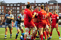 Jamie George (centre) of Saracens celebrates scoring his sides third try during the Heineken Champions Cup match between Cardiff Blues and Saracens at Cardiff Arms Park in Cardiff, Wales. Saturday 15 December 2018
