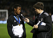 31st October 2017, Craven Cottage, London, England; EFL Championship football, Fulham versus Bristol City; Steven Sessegnon of Fulham being interviewed by Fulham during a half time wearing a FIFA Under-17 World Cup winners gold medal
