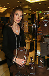 "Days - Kristen Alfonso shows jewelry line Hope - Faith - Miracles (necklace, earrings, rings, bracelets, pins, watches on November 29, 2008 at Bloomingdales, New York City, New York. ""The fleur de lis has been the symbol of my inspiration. It has brought me hope and the faith to believe in miracles."" (Photo by Sue Coflin/Max Photos)"