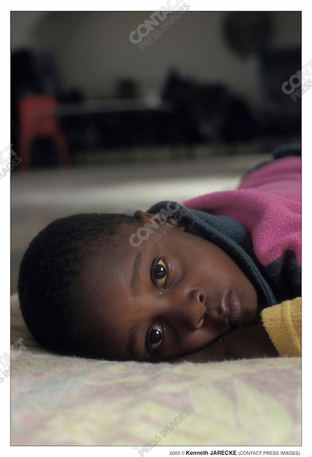 At a Catholic orphanage: Since Botswana has no orphanages where children can board, at the end of the day, the children return home to an extended family members' house. Suburbs of Gaborone, Botswana, August 2003...2003 © Kenneth JARECKE (CONTACT Press Images)