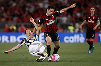 Calcio, finale Tim Cup: Milan vs Juventus. Roma, stadio Olimpico, 21 maggio 2016.<br /> AC Milan&rsquo;s Giacomo Bonaventura, right, is tackled by Juventus&rsquo; Stephan Lichsteiner during the Italian Cup final football match between AC Milan and Juventus at Rome's Olympic stadium, 21 May 2016.<br /> UPDATE IMAGES PRESS/Isabella Bonotto